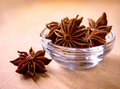 Star Anise in the Glass Bowl on Wooden Table Royalty Free Stock Photo