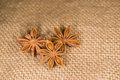 Star anise on a very old cloth few Stock Image