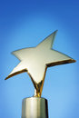 Star award against blue background dark Royalty Free Stock Photo