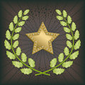 Star award with green oak wreath on black background Stock Photo