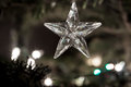 Star of glass with abstract background of holiday lights Royalty Free Stock Photo