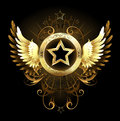 Star with golden wings gold a circular banner decorated and a pattern on a black background Stock Image