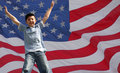 A Star jumping boy in front of usa flag Royalty Free Stock Photo