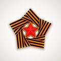 Star made of double Saint George ribbon with Red star within. Vector illustration.