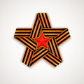Star made of interlaced Saint George ribbon with Red star within