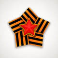 Star made of wide Saint George ribbon with Red star within. Vector illustration