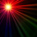 Star with rainbow light rays lens flare abstract over black background Stock Image