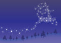 Star reindeer sparkling flying over trees at night Royalty Free Stock Photo