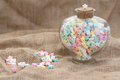 Star shape candy on burlap background texture glass jar heart lots of copy space Royalty Free Stock Images