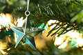Star shape Christmas ornament shining in silver Stock Photo