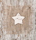 Star shape made of birch bark on the burlap Royalty Free Stock Photos