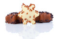 Star shaped christmas cookies with chocolate glaze on white Royalty Free Stock Photography