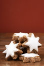 Star shaped cinnamon biscuit on table in front of red wall Royalty Free Stock Photo