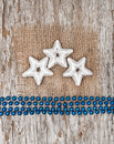 Star shapes burlap textile and chaplet on the old wood background Royalty Free Stock Photography
