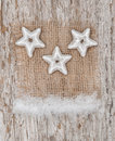 Star shapes and burlap textile on the old wood background Stock Photography