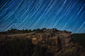 Star trail above rock cliff over sierra de albarracin aragon spain Royalty Free Stock Photos