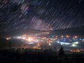 Star trails over mountain town Royalty Free Stock Photo