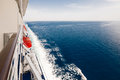 Starboard side of a cruise ship on the ocean Royalty Free Stock Photo