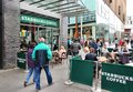 Starbucks coffee liverpool uk april people sit at on april in liverpool uk is the largest house company in the Royalty Free Stock Image