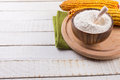 Starch in bowl on white wooden background selective focus Stock Photos