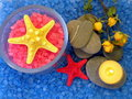 Starfish, bathsalt, candle and roses Stock Photography
