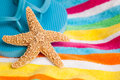 Starfish and flip flops on a beach towel Royalty Free Stock Photo