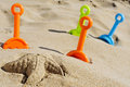 Starfish sand and toy shovels of different colors on the sand Royalty Free Stock Photo