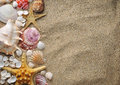Starfish and shells on sand near sea in summer Stock Images