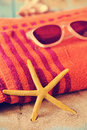 Starfish, sunglasses and beach towel Royalty Free Stock Photo