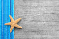 Starfish on wooden background in shabby style for a holiday or tropic travel concept Royalty Free Stock Image