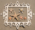 Starfishes with frame on the sandy beach wood Stock Image