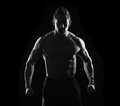 Stark strong man black and white flexing Royalty Free Stock Photos