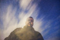 Starry night dreamy portrait of a man over and moving clouds Royalty Free Stock Photos