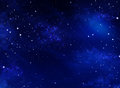 Starry night sky blue background in the open space Royalty Free Stock Photo