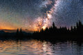Starry sky over the sea. Fantastic Milky Way. Meteor shower Royalty Free Stock Photo