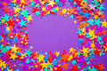 Stars confetti on a purple background, frame Royalty Free Stock Photo