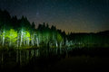 Stars in the night sky reflecting in deception pond at night in white mountain national forest new hampshire Royalty Free Stock Photography