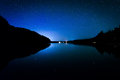 Stars in the night sky reflecting in echo lake at acadia nation national park maine Stock Photography