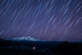 Stars over mountains a long exposure of in china Stock Photo