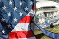 Stars and stripes with a classic americana vehicle in the background Stock Image