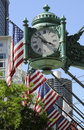 Stars and Stripes with company clock Chicago USA Royalty Free Stock Photo