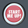 Start me up car starting button engine excitement arousal the words on a round ignition to illustrate getting excited motivated Stock Photos