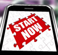 Start Now Smartphone Shows Commence Or Begin Immediately Royalty Free Stock Images