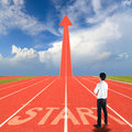 Start on running track businessman standing with and arrow Royalty Free Stock Photo