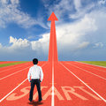Start on running track businessman standing with and arrow Stock Photo