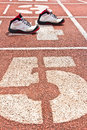 Start running track rubber standard red color with sport shoes Stock Photography
