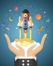 Start up concept. rocket flying on hands