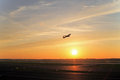 Starting airplane in front of the sun evening Royalty Free Stock Photo
