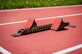 Starting block closeup of on running track Royalty Free Stock Photos