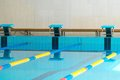 Starting blocks in a swimming pool and lanes Royalty Free Stock Photography